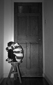 ashamed boy on stool